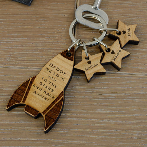 "This love you to the stars and back again rocket key ring is personalised with the recipients name and up to 3 children's names, one for each star. The rocket is engraved ""(recipient name i.e DADDY) I or WE LOVE YOU TO THE STARS AND BACK AGAIN!"". Upto 3 stars can be added and engraved each with a child's name and a heart!  Rocket Fob Size 60 x 34 x 5mm, Star Tag Fob Size 20 x 20 x 5mm. The key ring is presented in an organza drawstring bag."