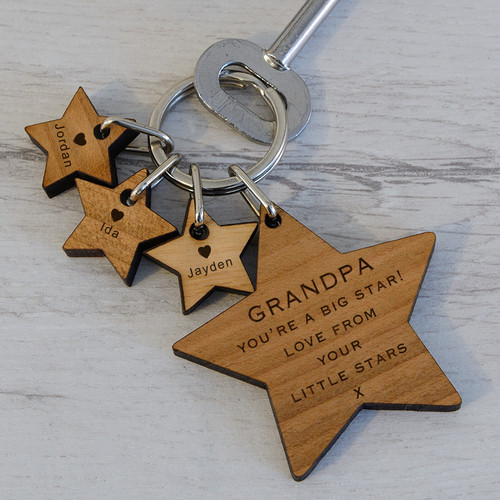 """This You're a Big Star key ring is personalised with the recipients name.  Upto 3 stars can be added and engraved each with a child's name and a heart!  The message on the large star will be from """"your little star"""" for one child's name and """"from your little stars"""" for 2 or 3 additional little stars.  Fob Size 50 x 50 x 5mm, Fob Size star tag 20 x 20 x 5mm. The key ring is presented in an organza drawstring bag."""