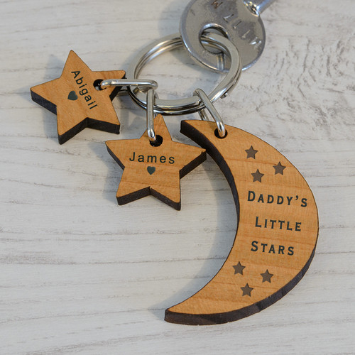 "This Little Stars key ring is personalised with the recipients name and up to 3 children's names, one for each star. The moon is engraved ""(recipient name i.e DADDY) LITTLE STARS"". Upto 3 stars can be added and engraved each with a child's name and a heart!  Fob Size moon 40 x 17 x 5mm, Fob Size stars 20 x 20 x 5mm.   The key ring is presented in an organza drawstring bag."