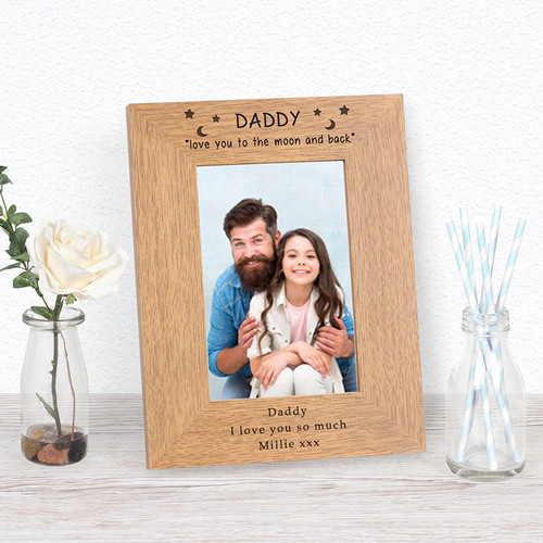 """This """"Love you to the moon"""" photoframe is a great gift for any Daddy. The bottom of the frame is left free for your own personalised message. The frame holds a 6x4 photograph (outer dimensions are 220mm x 170mm)."""