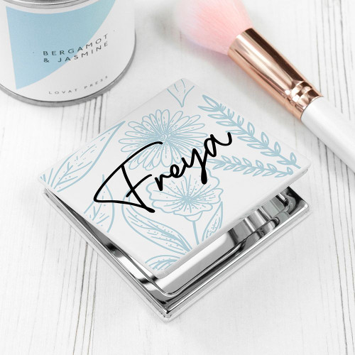 Square metal compact mirror with a floral design. Can be personalised with a name up to 12 characters.