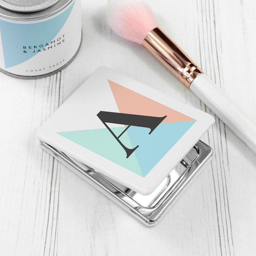 Metal compact mirror which can be personalised with one letter.