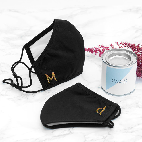 This Just Love Gifts Fitted Face Covering is reusable, washable and adjustable so one size fits all.  Personalise your mask with your initial, and show off your style by choosing from 2 fonts and 9 different colour options.  The stylish face covering is the perfect solution for everyday protection for personal and professional use.  A 3-layered covering that curves gently around the face, it has adjustable ear toggles that can be pulled along the ear loop to the desired tightness, to ensure natural comfort and easy sizing.  Each face covering is made from an ultra-soft cotton for comfortable wearing and offers a high level of breathability because of its unique fit. Machine washable at up to 60°C and up to 50 times.   This face covering supplements the physical distancing standard to reduce further transmission of the (COVID-19) coronavirus from respiratory droplets. The face covering is not to assist the wearer but to protect against inadvertent transmission of the coronavirus to others if the wearer has it asymptomatically. Please note this is not a medical mask and should not be worn as personal protective equipment. The face covering does not guarantee safety or protection. Face coverings should not be used as a replacement for social distancing or self isolation. Face coverings should not be worn by those who may have breathing difficulties whilst wearing a face covering or whilst exercising