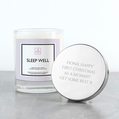 A combination of kind, natural and luxury.  Using only organic soy wax, cotton wicks and natural ingredients.  The scent Sleep Well combines lavender and ylang ylang to wind down, or simply to add an air of luxury.  To add an extra special touch, personalise with a message on the lid of the candle.  Using recycled glass and packaging, you can be safe in the knowledge that your candle has been made with 'giving back' in mind.  40 hours burn time. Hand made in the UK No animal or paraffin derived ingredients  Top tips for looking after your candle:  1. When lighting for the first time, always allow to burn for two hours. This will allow wax to pool evenly for the duration of its burn time. (Take note too, that ideally, candles should not be burned for more than four hours at a time)  2. Never blow out a candle! To ensure a perfect burn and to not compromise the oils with bacteria use the lid to snuff out the flame.  3. Always give the wick a little trim (about half a centimetre) before relighting. This ensures less soot is formed when the candle is burning and that the oils are kept beautiful.  4. Light candles one hour prior to the arrival of guests for that maximum punch of fragrance.