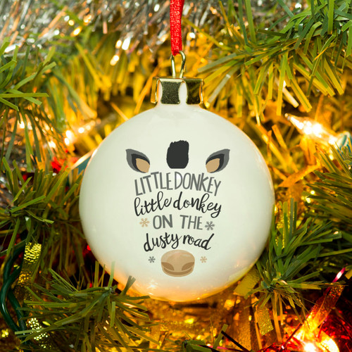 Add a personal touch to the tree this year with this lovely bone china bauble. Personalise with a message on the reverse over 4 lines of 20 characters. The long lasting decoration can be used year after year. Dimensions: 6cm x 6cm.