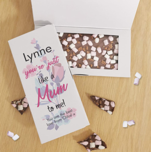 Let someone know how much they mean to you with their very own personalised chocolate card! It includes a personalised card box that holds a delicious bar of 100g Rocky Road milk chocolate. The outside of the box can be personalised with their name above the fixed text 'You're just like a Mum to me!' and below with a special message below over 2 lines of up to 25 characters per line. Allergy Advice: Contains: Milk and Soya. May Contain: Traces of Nuts