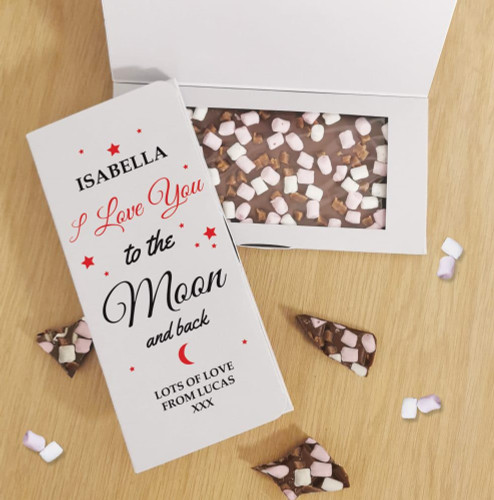 Let someone know you are thinking of them, with their very own personalised chocolate card! It includes a personalised card box that holds a delicious bar of 100g Rocky Road milk chocolate. The outside of the box can be personalised with a name above the fixed text 'I love you to the moon and back' and a special message below over 3 lines of up to 20 characters per line. Allergy Advice: Contains: Milk and Soya. May Contain: Traces of Nuts