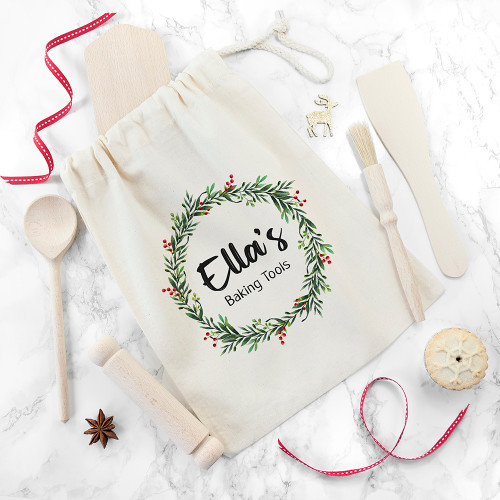 To celebrate Christmas, why not gift your little one a cute baking set so they can feel they're helping out in preparation of the celebrations? The set comes with child-friendly rolling pin, pastry brush, wooden spoon, rolling board and spatula, they are ready, set to bake!  The set is presented in a cream zip up bag featuring a beautiful Christmas wreath which can be personalised with their name.