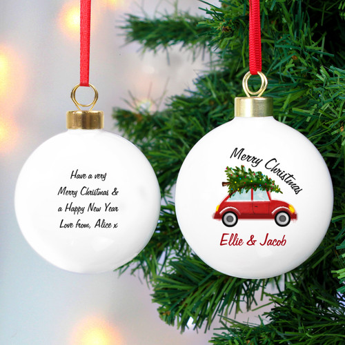 Spread Christmas cheer with this delightful personalised `Driving home for Christmas` Bauble. It will look the part hung on a tree or as a decoration for the home.  The bauble can be personalised with a Line on the front above the design up to 20 characters and a further line underneath the bauble up to 15 characters.  A message can be added to the back of the bauble over 4 lines up to 20 characters per line.  Please note that all text is case sensitive and will appear as entered. Please avoid entering your message in block capitals as this may result in the personalisation being difficult to read.  The bauble comes supplied with a ribbon ready to hang straight onto the tree. The ribbon colour may vary.  The style of bauble topper may vary.  Ideal for Christmas.