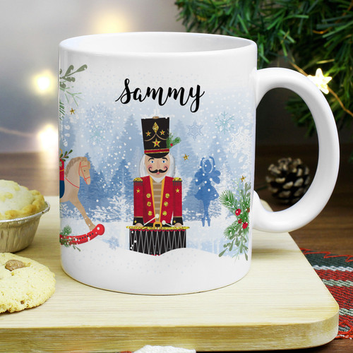 Personalise this Nutcracker Christmas Mug with a name up to 12 characters. Perfect for snuggling up on the sofa with a hot chocolate at Christmas.  A message can also be added on the reverse up to 4 lines, 25 characters per line.  NOTE: Due to the font type used please refrain from using all capitals in your personalised message particularly on the first line as this will make the name difficult to read.  Hand washing is recommended.  Material is ceramic. Suitable for Christmas.
