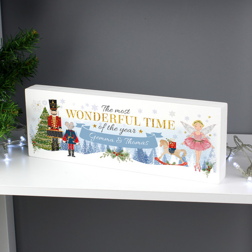 """This adorable Personalised Christmas Nutcracker Wooden Block Sign would make a fantastic addition to a small child's bedroom to add to the Christmas excitement or would look great on a mantelpiece.  Personalise this wooden block sign with 1 line of text up to 25 characters.  All text will appear as entered. The wording """"The most wonderful time of the year"""" is fixed text and cannot be amended. Please avoid entering your personalisation in all capitals as this may result in your message being unreadable.  Ideal for placing on a mantelpiece or shelf.  Please note that these items are made from solid wood and therefore may contain some imperfections due to their natural material.  Perfect gift for Christmas."""