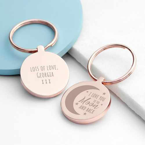 Our beautiful 'love you to the moon and back' keyring is sure to show how much you care about a special someone. A gorgeous treasurable gift for any loved one.   Each keyring can be personalised with a thoughtful message engraved on the back.   Love you to the moon and back appears as standard text on the front of the keyring.  Available in Silver or Rose Gold.  Dimensions:  L: 7.1cm W: 3.5cm D: 0.5cm