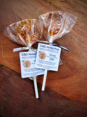 Two CBD honey pops, each with 18 mg CBD and made with raw, unfiltered orange blossom honey.