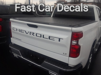 rear of white 2019 Chevy Silverado Tailgate Stripes CHEVROLET Letters 2019-2020