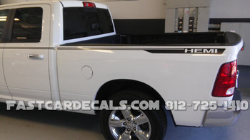 side view of white 4X4 HEMI Dodge Ram 1500 Truck Stripes HUSTLE 2009-2016 2017 2018