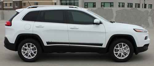 side of white 2019 Jeep Cherokee Stripes BRAVE 2014-2021