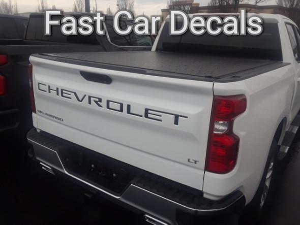rear of white 2019 Chevy Silverado Tailgate Stripes CHEVROLET Letters 2019-2021