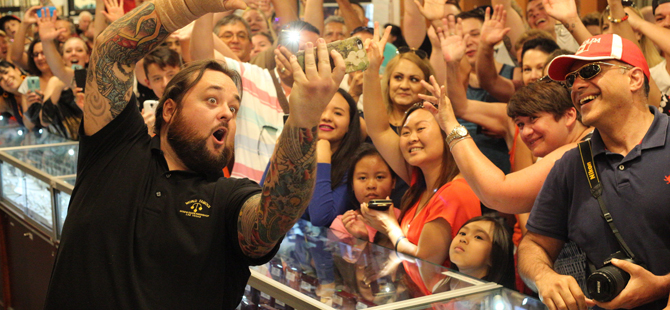 Chumlee of Pawn Stars taking a photo with the crowd in law vegas