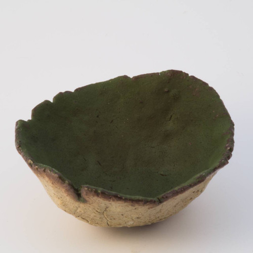 A rich silky green stoneware thumb pot, glazed on the inside and a thin clear glaze wash on the outside.