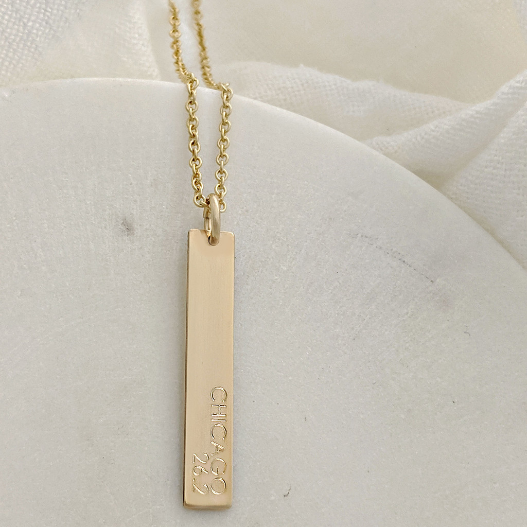 Chicago Marathon 26.2 Bar Necklace. Shown engraved in century font, gold fill bar on cable chain.
