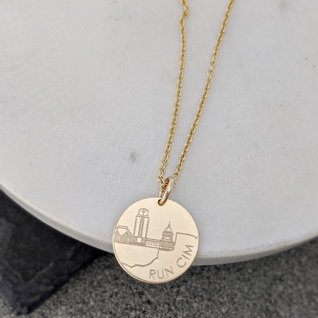 "California International Marathon necklace. Shown in 5/8"" gold fill on cable chain."