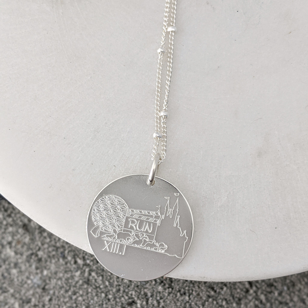 Disney running necklace. Shown in sterling silver on satellite chain.