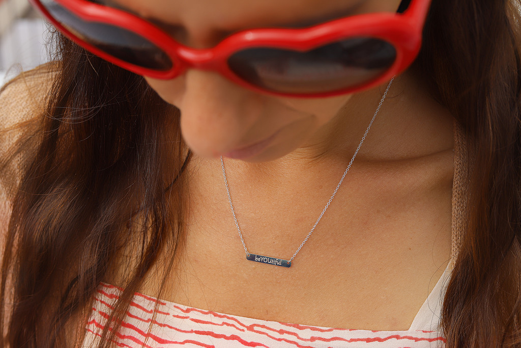 Engraved petite bar necklace. Shown in sterling silver. Gabriola font.