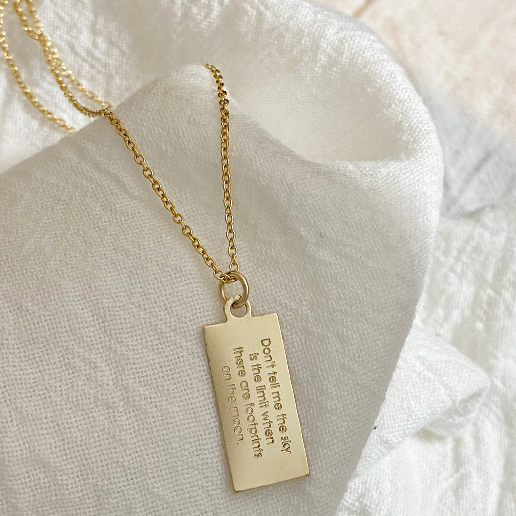 Personal mantra tag necklace. Shown in gold fill on cable chain. Century font.