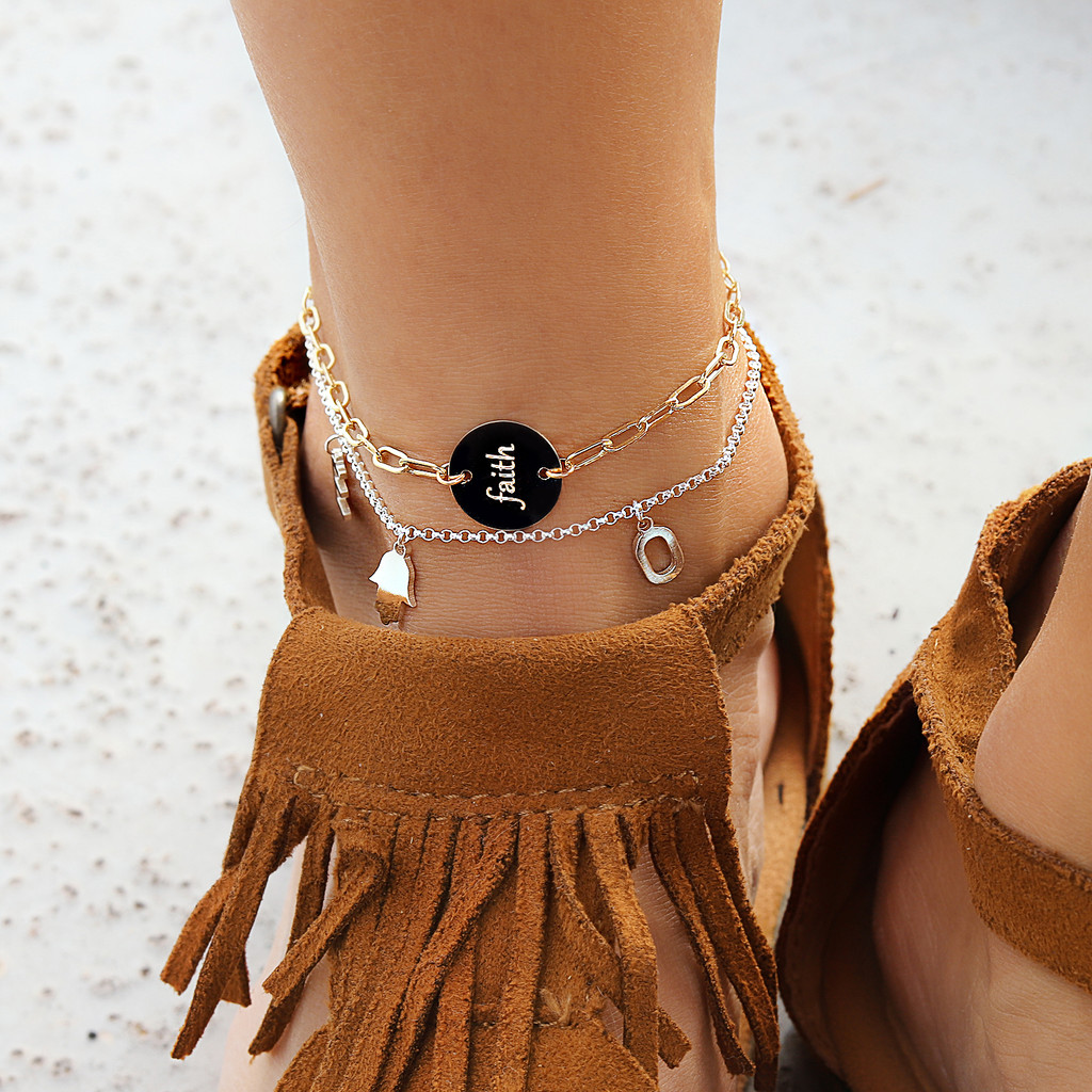 Engraved disc anklet. Shown in gold fill on elongated chain. Gabriola font.