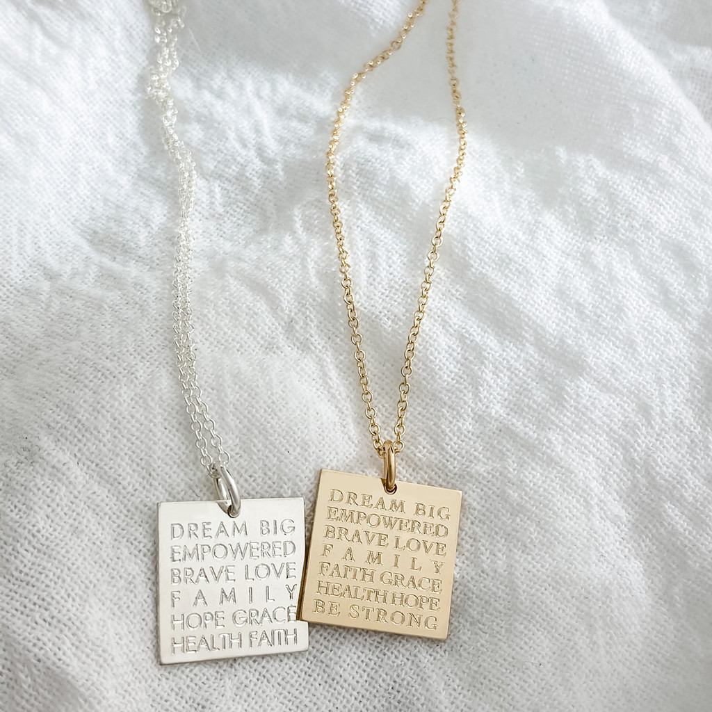 Sterling silver on cable chain shown in Century font. Gold fill on cable chain shown in Cochin font.