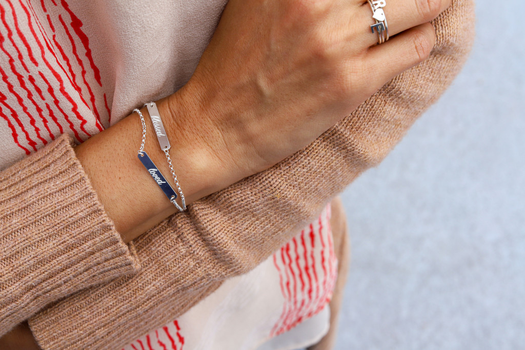 Sterling silver bracelet. Shown with petite bar on rolo chain, atlas font.