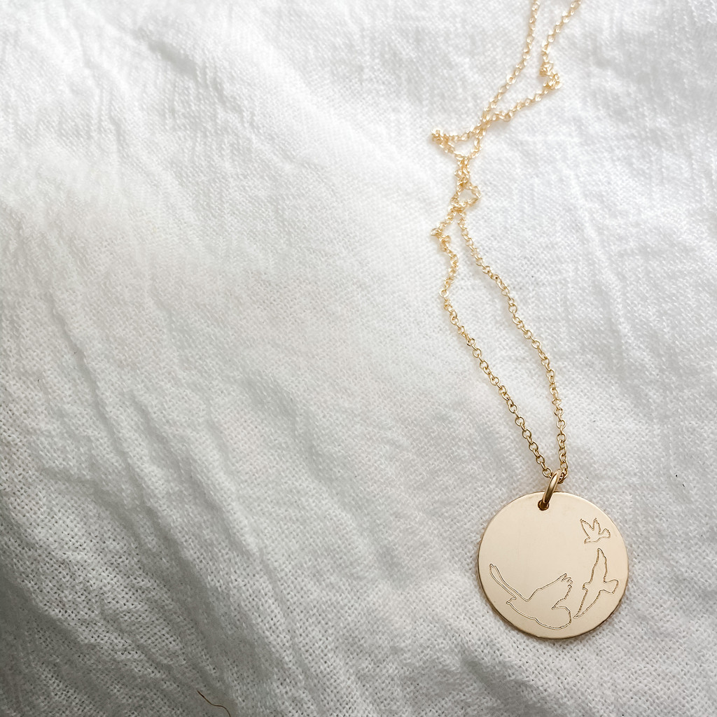 """Three Little Birds Engraved necklace. Shown in 3/4"""" gold fill on cable chain."""