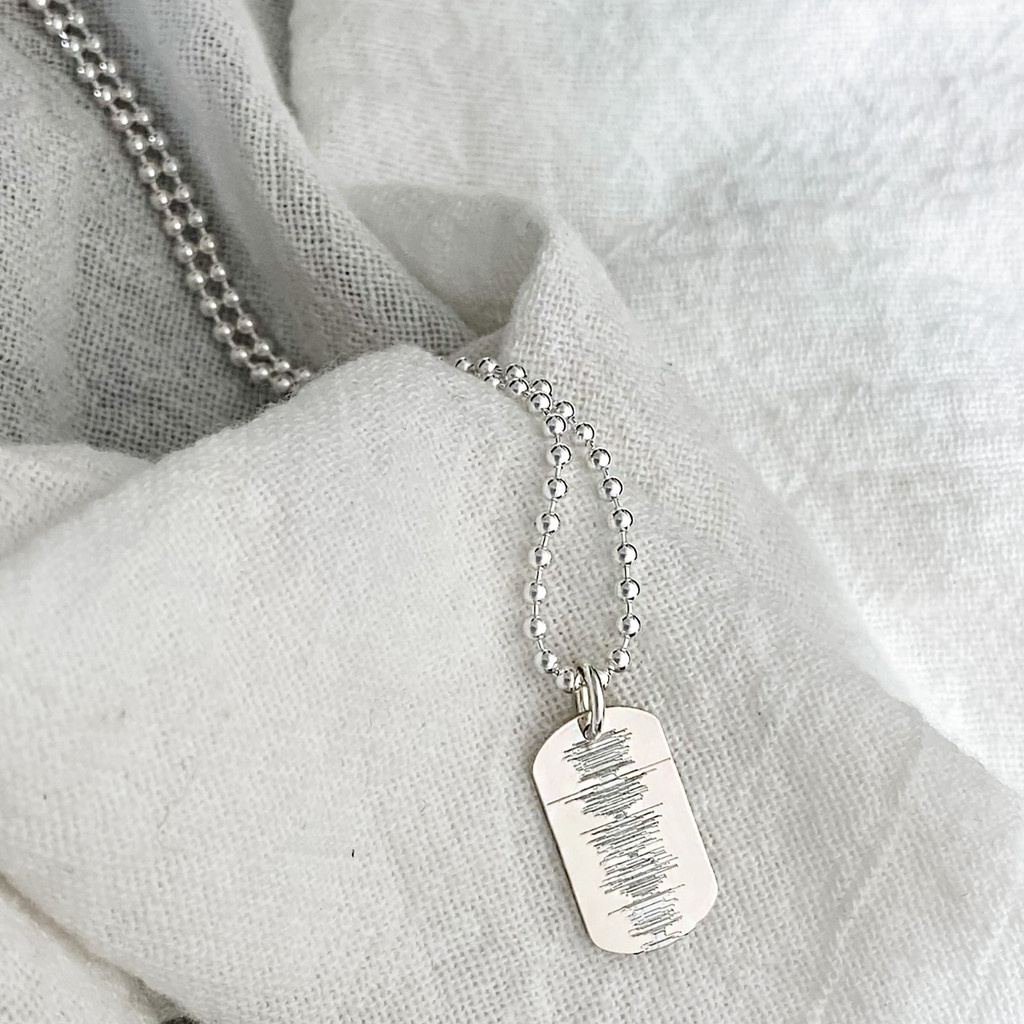 """Sound wave custom engraved from an audio file. Sterling silver small dog tag, shown on a 24"""" ballchain."""