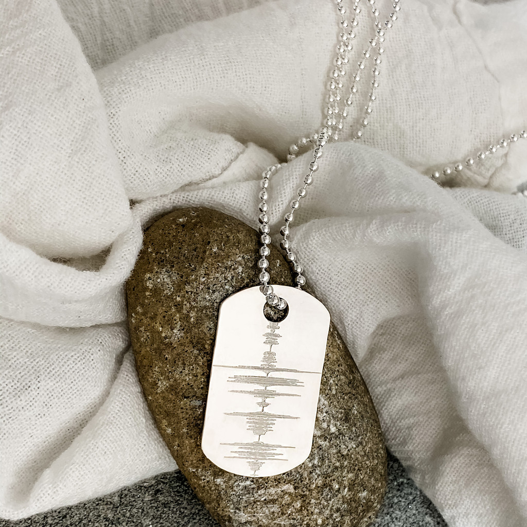 """Custom engraved sound wave from an audio file. Sterling silver dog tag, shown on a 24"""" ballchain."""