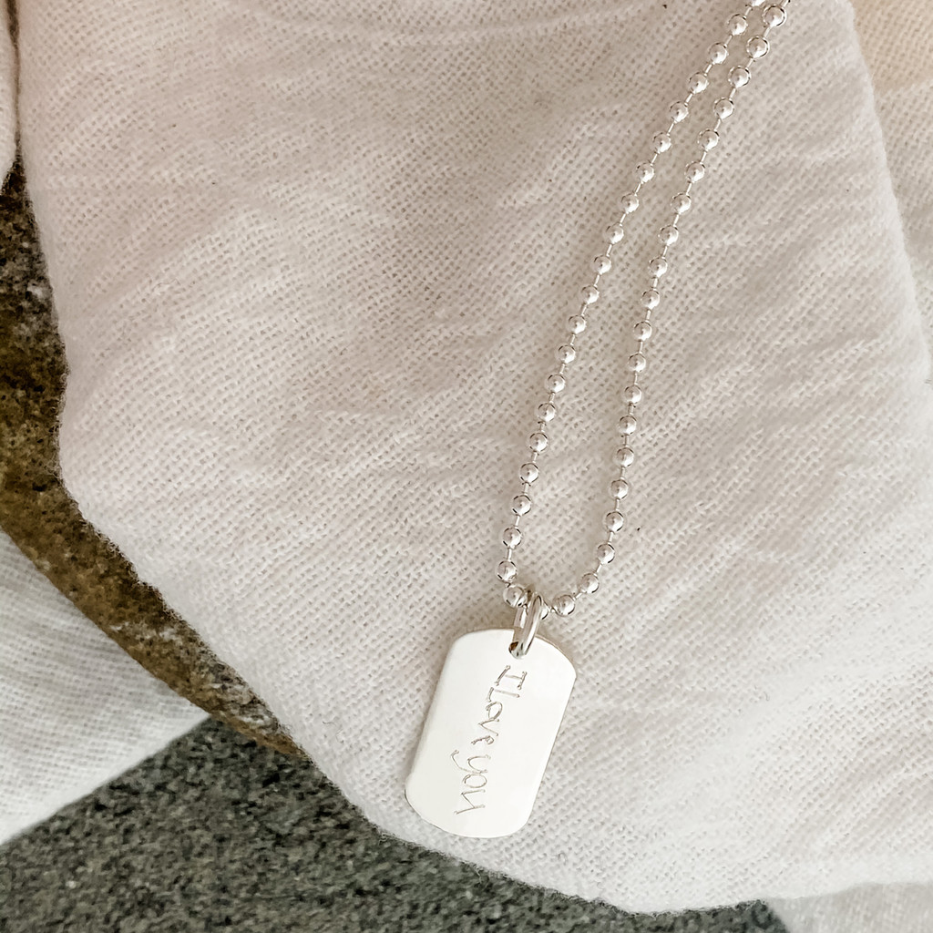 """Custom engraved handwriting taken from love notes. Small dog tag shown on a 24"""" ball chain."""