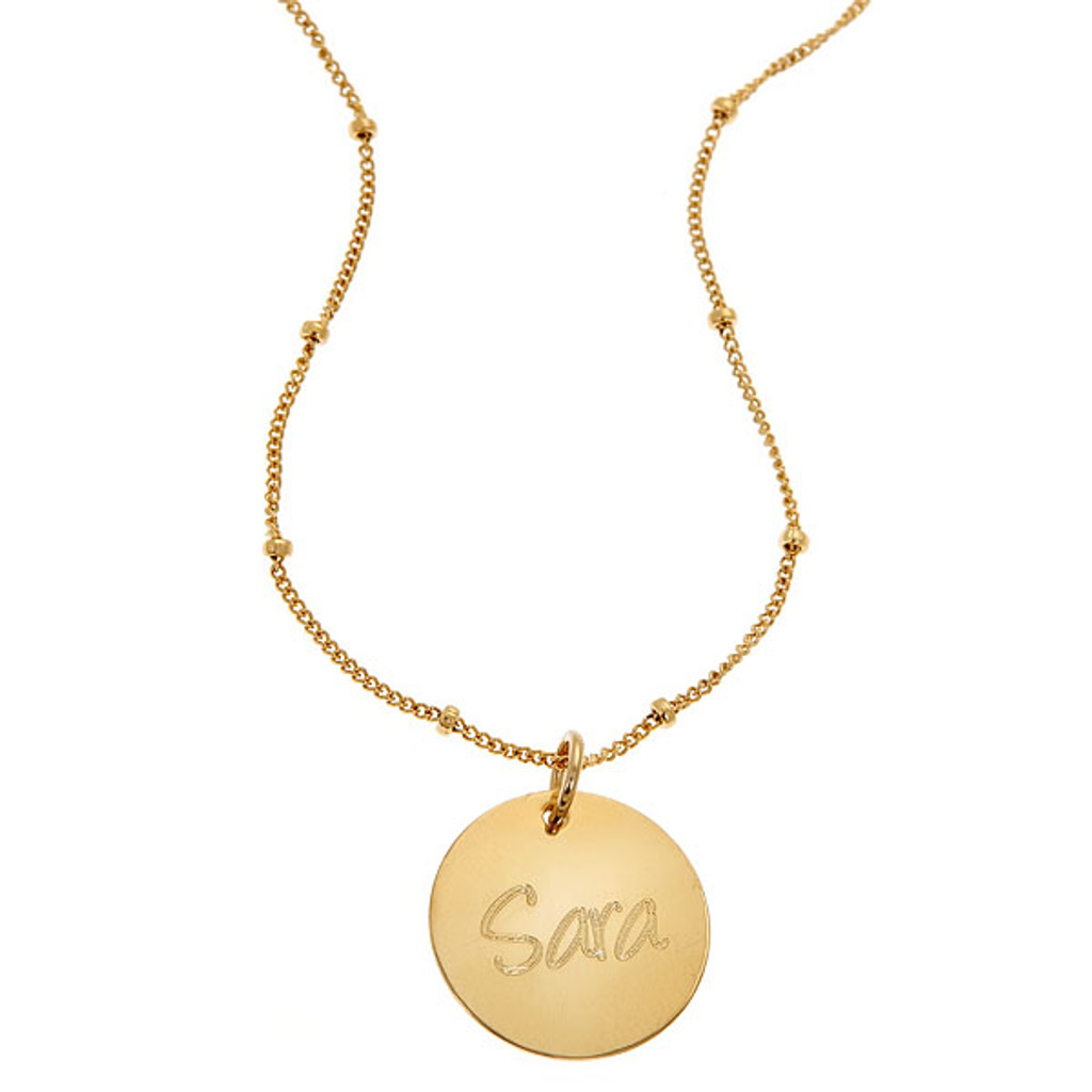 Custom engraved name disc necklace. Shown in gold fill on satellite chain.