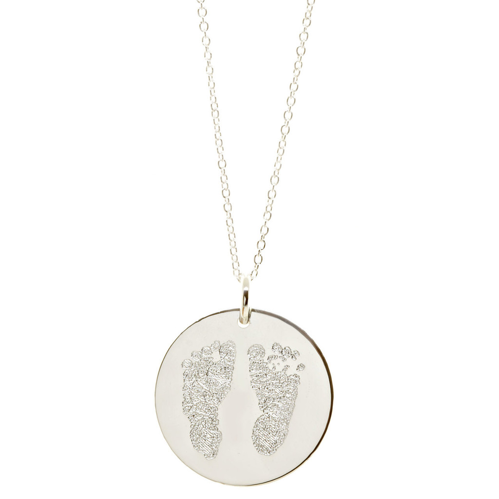 Custom engraved baby footprint necklace. Shown in sterling silver on fine cable chain.