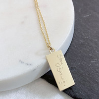 Stay. Strong. by Molly Huddle. Shown in gold fill tag on cable chain.