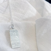 Coach defined necklace. Shown in sterling silver on cable chain.