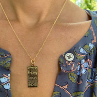 Sister defined engraved tag necklace.