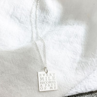 EVERY MILE BECOMES A PART OF ME. Shown in sterling silver on cable chain.