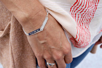 Sterling silver bracelet. Shown with petite bar on rolo chain, century font.