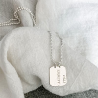 """Personalized sterling silver small dog tags. Shown in cochin font on a 24"""" ballchain."""