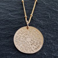 Generation necklace engraved with family names. Shown in gold fill on satellite chain.