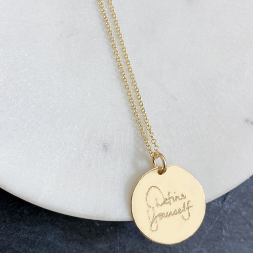 "Define Yourself by Deena Kastor necklace. Shown in 3/4"" gold fill disc on cable chain."