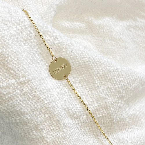 Engraved Disc Bracelet. Shown in gold fill. Engraved in ROMAN font.