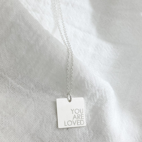 Mantra Square Necklace. Shown in sterling silver on a cable chain. Century font centered right.