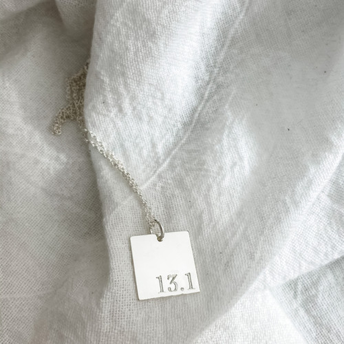 13.1 Square necklace. Shown in sterling on a cable chain, in cochin font.