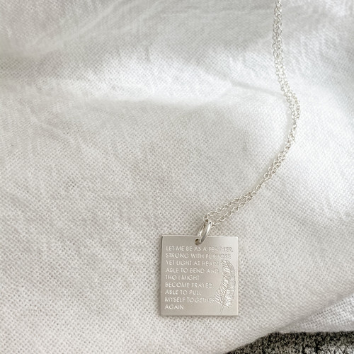 """LET ME BE AS A FEATHER, STRONG WITH PURPOSE YET LIGHT AT HEART. ABLE TO BEND AND THO I MIGHT BECOME FRAYED, ABLE TO PULL MYSELF TOGETHER AGAIN."" Shown in sterling silver on a cable chain."