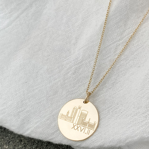 Manchester NH Skyline necklace. Shown in gold fill on cable chain.